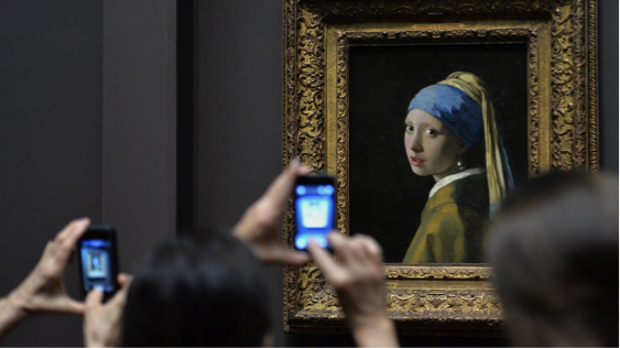 Johannes Vermeer's painting, Girl With a Pearl Earring, the inspiration behind Chevalier's book.   The painting is now on display in New York's Frick Collection.   Image from: npr.org