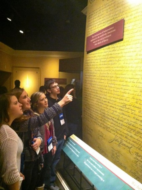 A group of students read The Declaration of Independence at the Smithsonian.   Image from: thetimes-tribune.com