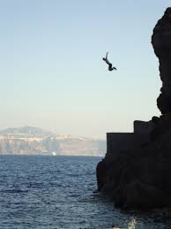 Man cliff diving into the ocean