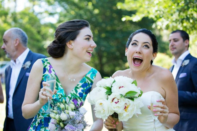 Me and my sister at her wedding. This is our default face when we are together, just without professional makeup.